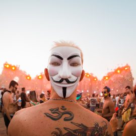 SAO PAULO, BRAZIL - APRIL 23: Music fan with V for Vendetta mask during the third day of the Tomorrowland music festival at Parque Maeda Itu on April 23, 2016 in Sao Paulo, Brazil. (Photo by Mauricio Santana/Getty Images)